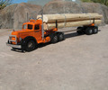 Orange and black LF log truck